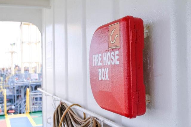 Fire hose box and fire signage